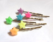 Neon. A set of six different color puff up petite stars on copper hair clips.