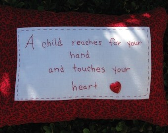 A Child Reaches for Your Hand and Touches Your Heart - Hand Embroidered Pillo