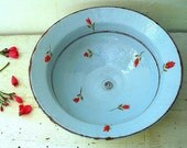 A blue bowl with red flowers