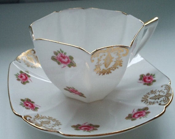 vintage pink roses and gold gilt art deco tea cup and saucer. Black Bedroom Furniture Sets. Home Design Ideas