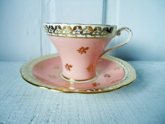 Candy Pink and Heavy Gold Gilt Corset Shape Teacup and Saucer
