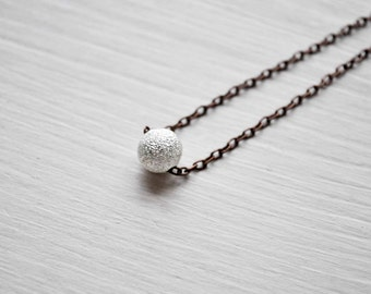 tiny stardust -necklace (mini silver sparkly bead on a vintage bronze chain minimal discreet neckpiece)