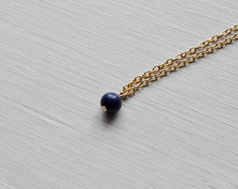 tiny little world -necklace (tiny lapis blue bead on a gold plated chain)