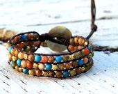 Arizona, turquoise, jasper, and cut brass triple leather cuff bracelet