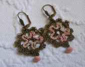 Crochet earrings with embroidery and glass button in antique gold and coral pink