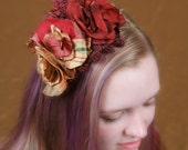 Silk Fascinator is shades of red