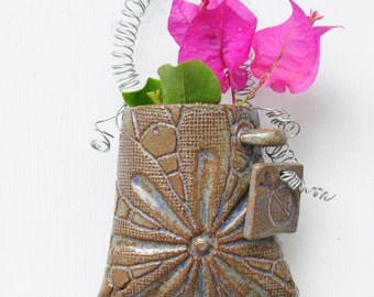 blue daisy ladybug dingle wall pocket