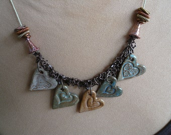 Five hearts in a row necklace