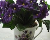 Violets and Ivy Tea Cup Floral Arrangement