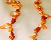 pearl necklace- organic shaped,hand knotted,orange pearls- 18 inches