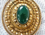 Gold colored pin with green glass focal probably from the 50's or 60's - nice Valentine gift