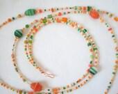 Green, cream, and orange necklace