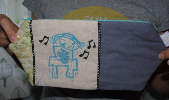 singing and dancing girl handprinted clutch