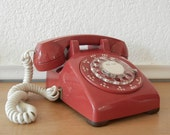 Red Desk Telephone with Rotary Dial and White Cord