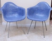 Pair of Blue Herman Miller Chairs designed by Eames