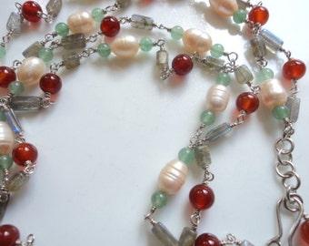 Multi-coloured layered gemstone necklace.
