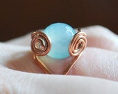 Ring With Copper Wire Wrapped Semi Precious Multi Faceted Light Blue Stone