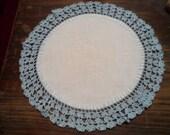 Vintage hand crocheted blue edge doily