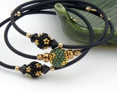 Stacking Bangles - set of 3 handmade beaded bead memory wire bracelets - black sage green and gold