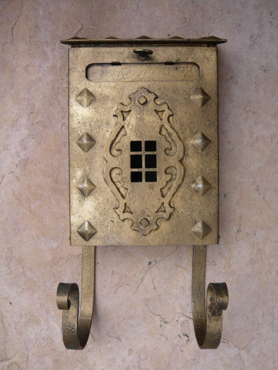 Very decorative 1920s mailbox with newspaper holder