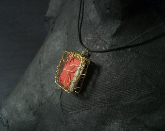 Tiny book in leafy cage - brass wire pendant on waxed cord