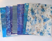 Hand printed papers, set of 7