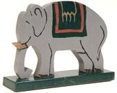 Vintage folk art painted wooden toy elephant.