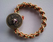 Green/Orange Spiral Weave Harmony Bracelet