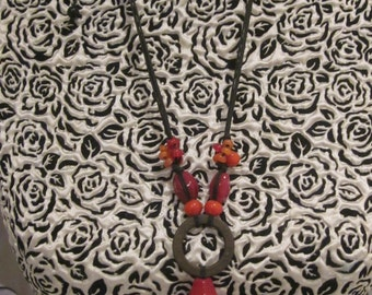 """Vintage look brick red stone beads with ring of steel necklace. ..""""red heat"""""""
