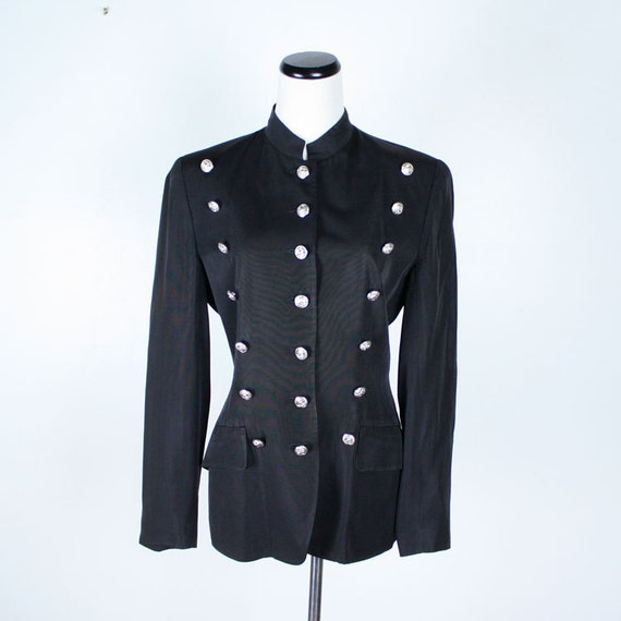 Green Black Military Marching Band Drummer Jacket New Style is amazingly designed military jacket in our list. This jacket features contrasting Green detailed braiding on the front of the jacket .