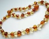 Baroque Baltic Amber Baby  Teething Necklace. Cognac and Light colors.