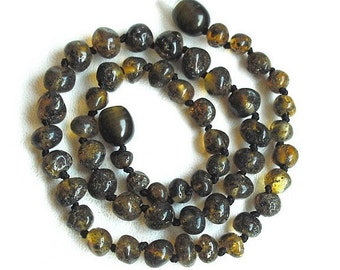 Dark Green colored rounded  beads Baltic Amber teething necklace for your baby handmade knotted .High quality amber.
