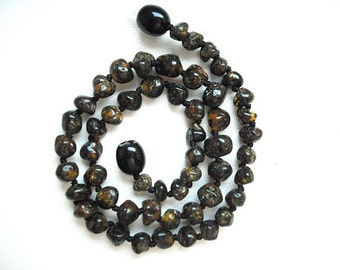 Dark colored  rounded  beads Baltic Amber teething necklace for your baby handmade  knotted .
