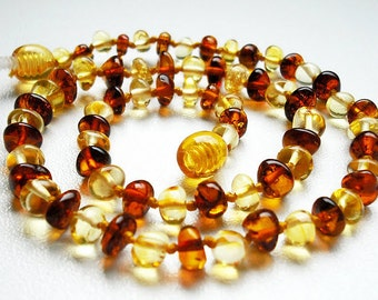 Light and Honey rounded shape Natural  Baltic Amber teething necklace for your baby .