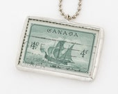 Soldered Pendant with a vintage 1949 Canadian postage stamp