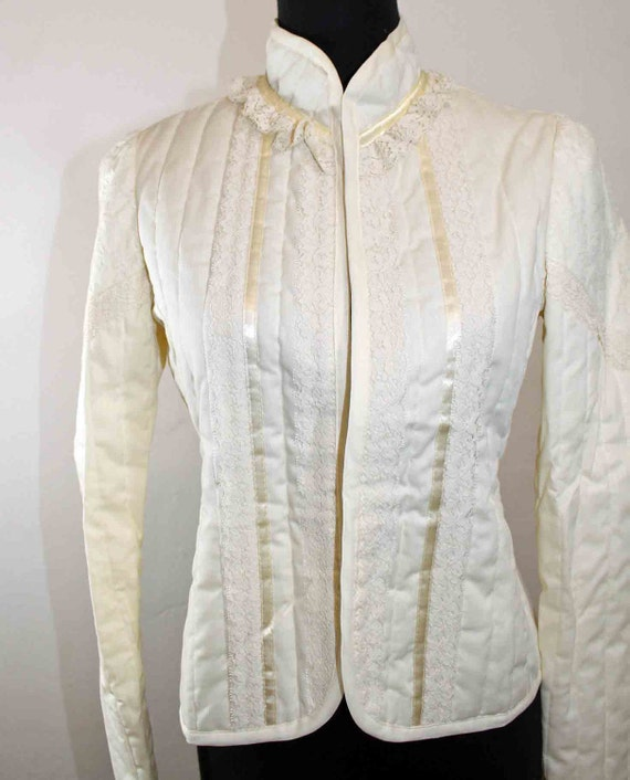 1970s Gunnies by Jessica Mc Clintock Ivory colored lace and ribbon quilted Gothic Lolita jacket.