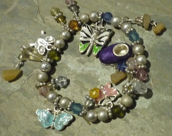 Butterfly kiss  - tiny colorful beads and charms on an elastic strand.