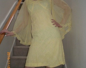 1960s yellow lacy mode dress with angle wing sleeves