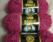 Four skeins of Lion Boucle Yarn in Rose