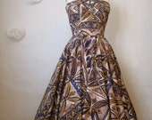1950s hawaiian dress. vintage full skirt dress. aztec tribal tiki keyhole halter.