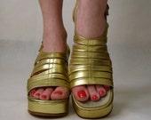 vintage 1970s platforms. metallic gold shoes. leather gladiator sandals. greek goddess glam high heels.