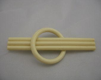 Art Deco Celluloid Rod and Circle Pin