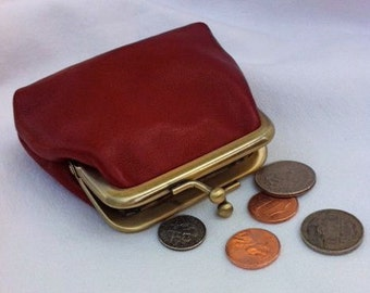 Red leather handmade coin purse with gold kiss lock frame.