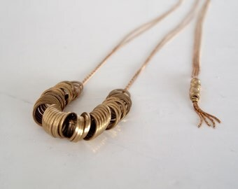 Ceri - geometric brass rings on vintage brass chain long necklace