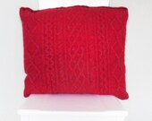 Recycled Wool Cushion / Pillow Throw . Knitted Red chunky cable cover with small grey button fastenings .