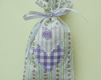 Lavender scented bag in floral fabric with heart and button decoration.