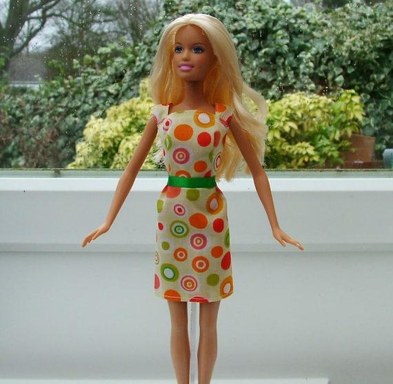 Barbie dolls clothes handmade. Spot fabric dress to fit Barbie type dolls.