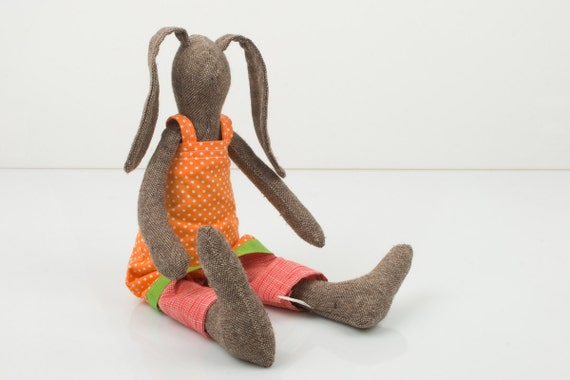 stuffed animal - brown rabbit wearing orange  dress with polka dots and under woven fabric pink pants  - handmade fabric doll free shipping