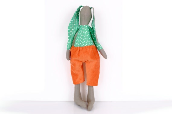 Olive parties rabbit   Wearing a shirt with green dots And orange corduroy pants  -handmade fabric doll
