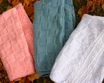 New Born  This is a hand knitted baby blanket in pink, blue or white. it is 25 inches by 25 inches
